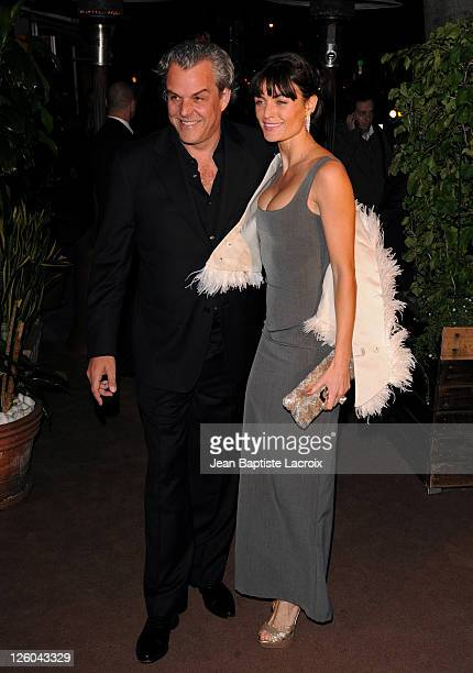 Danny Huston and Lyne Renee sighted attending Chanel and Charles Finch preOscar party celebrating fashion and film at Madeo restaurant on February 26...