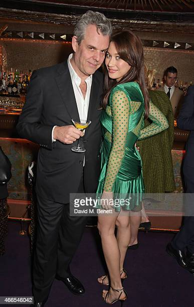 Danny Huston and Olga Kurylenko attend the Dior And I UK Premiere after party at Loulou's on March 16 2015 in London England