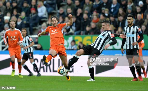 Danny Hylton of Luton Town and Ciaran Clark of Newcastle United during the The Emirates FA Cup Third Round match between Newcastle United and Luton...
