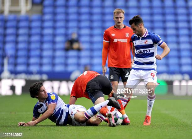 Danny Hylton of Luton Town is challenged by Tom McIntyre and Sam Baldock of Reading FC during Carabao Cup Second Round match between Reading FC and...