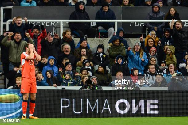 Danny Hylton of Luton Town is disappointed after celebrating to Newcastle fans after his second goal is ruled offside during the Emirates FA Cup...