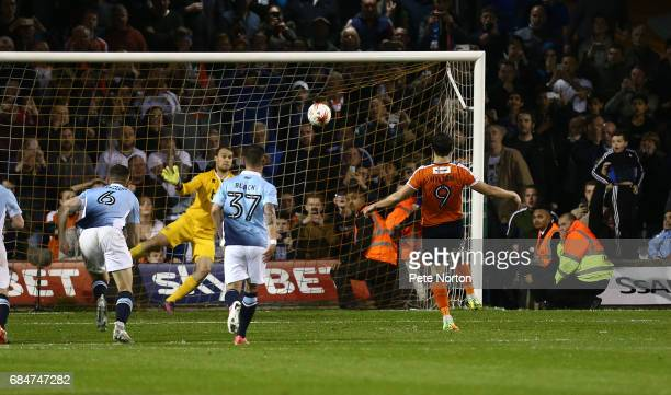 Danny Hylton of Luton Town scores his sides third goal from the penalty spot during the Sky Bet League Two Play off Semi Final Second Leg match...