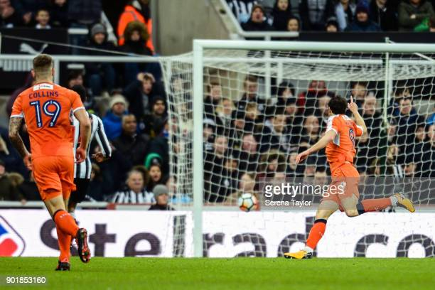 Danny Hylton of Luton Town scores Luton's first goal during the Emirates FA Cup Third Round between Newcastle United and Luton Town at StJames' Park...