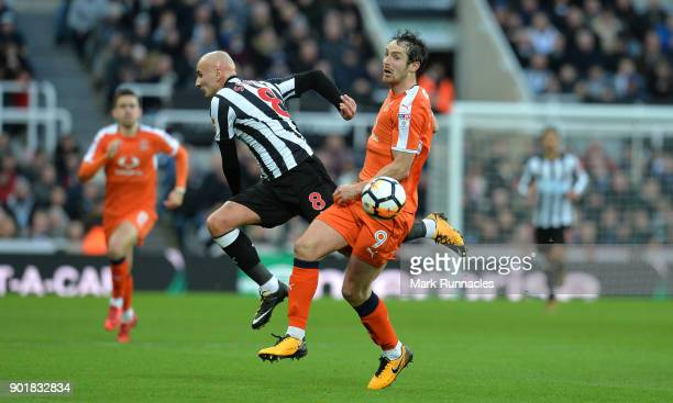 Danny Hylton of Luton Town tackles Jonjo Shelvey of Newcastle United during the The Emirates FA Cup Third Round match between Newcastle United and...