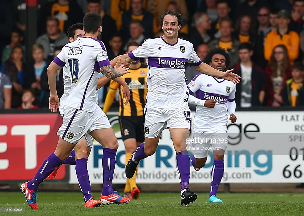 Danny Hylton of Oxford celebrates with team mates after scoring the first goal of the game during the Sky Bet League Two match between Cambridge United and Oxford United at The Abbey Stadium on October 11, 2014 in Cambridge, England.