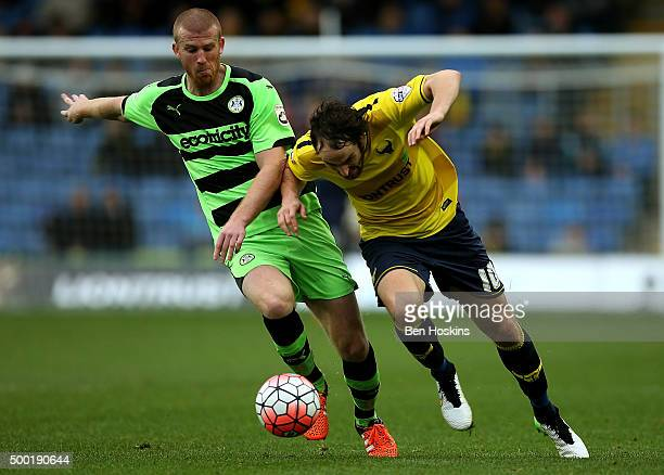 Danny Hylton of Oxford holds off pressure from Charlie Clough of Forest Green during The Emirates FA Cup Second Round match between Oxford United and...