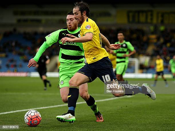 Danny Hylton of Oxford holds off pressure from Sam Wedgbury of Forest Green during The Emirates FA Cup Second Round match between Oxford United and...