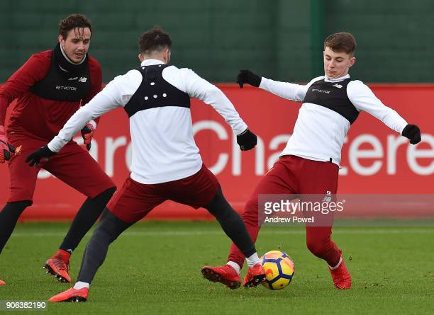 Danny Ings and Ben Woodburn of Liverpool during a training session at Melwood Training Ground on January 18 2018 in Liverpool England