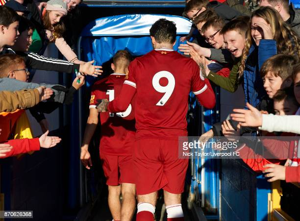 Danny Ings and Herbie Kane of Liverpool are cheered off the pitch by fans after the Liverpool v Bristol City U23 Premier League Cup at The Swansway...