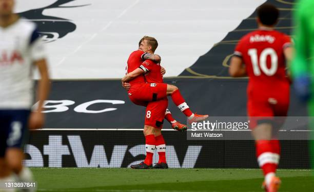 Danny Ings and James Ward-Prowse of Southampton celebrate during the Premier League match between Tottenham Hotspur and Southampton at Tottenham...