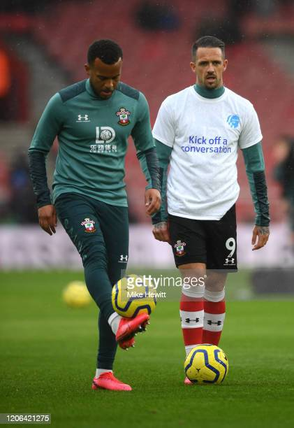 Danny Ings and Ryan Bertrand of Southampton warms up while wearing a Heads Up Campaign tshirt prior to the Premier League match between Southampton...