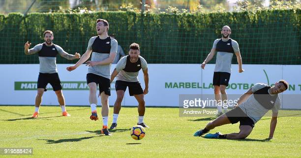Danny Ings Andrew Robertson and Alex OxladeChamberlain Adam Lallana and Trent AlexanderArnold of Liverpool react during a training session at...