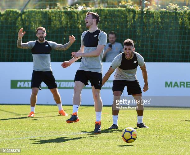 Danny Ings Andrew Robertson and Alex OxladeChamberlain of Liverpool react during a training session at Marbella Football Center on February 17 2018...