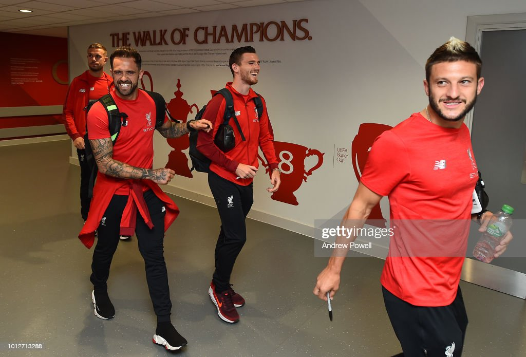 Danny Ings, Andy Robertson and Adam Lallana of Liverpool arrive before the Pre-Season friendly match between Liverpool and Torino at Anfield on August 7, 2018 in Liverpool, England.