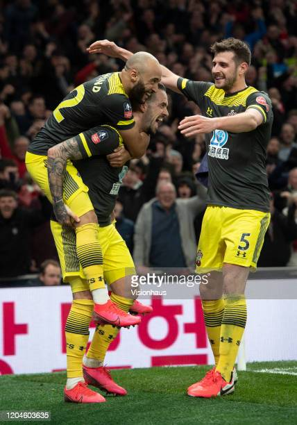 Danny Ings celebrates scoring Southampton's second goal with Nathan Redmond and Jack Stephens during the FA Cup Fourth Round Replay match between...