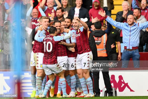 Danny Ings of Aston Villa celebrates with teammates after scoring their side's first goal during the Premier League match between Aston Villa and...