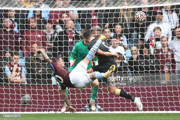 Danny Ings of Aston Villa scores their side's first goal from an overhead kick during the Premier League match between Aston Villa and Newcastle...