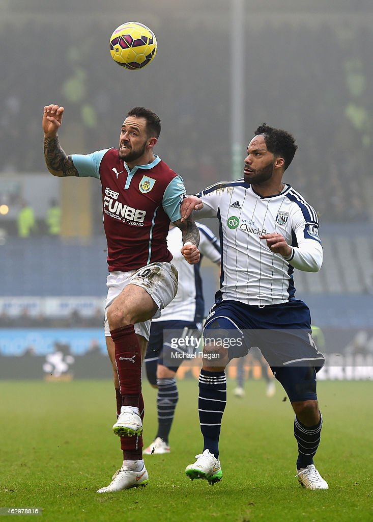 Danny Ings of Burnley and Joleon Lescott of West Brom compete for the ball during the Barclays Premier League match between Burnley and West Bromwich Albion at Turf Moor on February 8, 2015 in Burnley, England.
