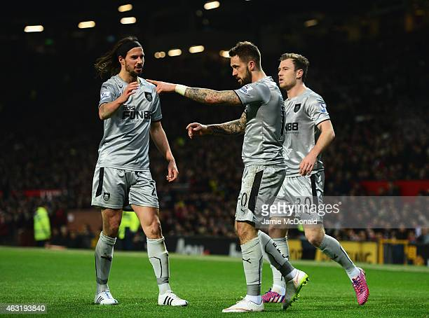 Danny Ings of Burnley celebrates his goal with team mates during the Barclays Premier League match between Manchester United and Burnley at Old...
