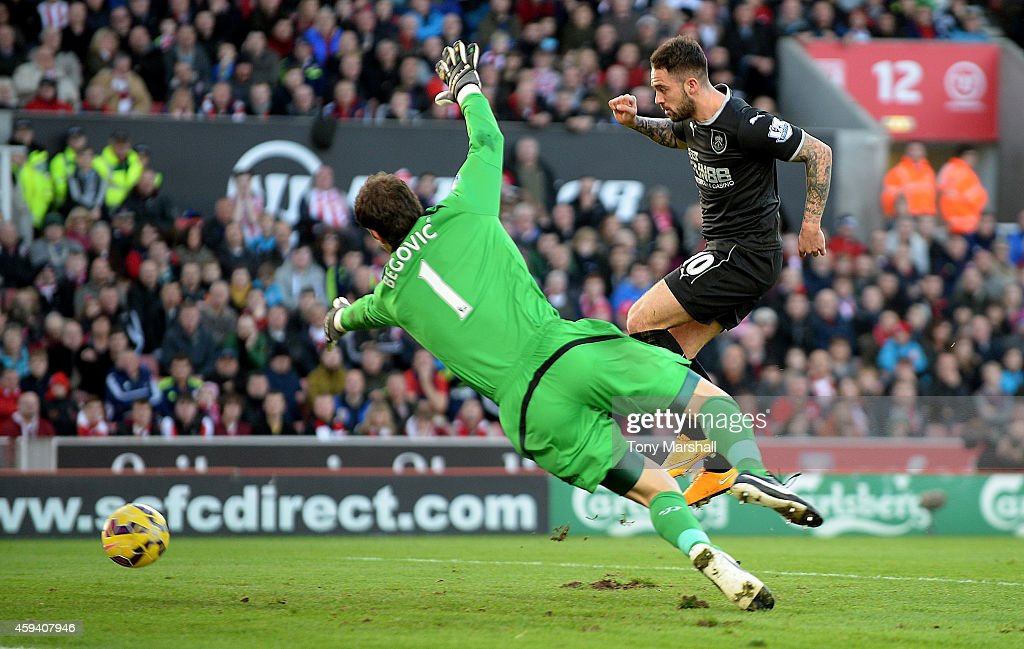 Danny Ings of Burnley celebrates scores the second goal during the Barclays Premier League match between Stoke City and Burnley at the Britannia Stadium on November 22, 2014 in Stoke on Trent, England.