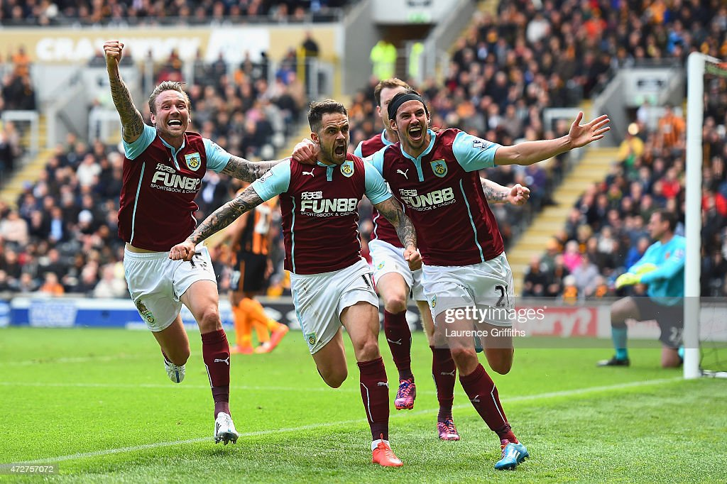 Danny Ings (C) of Burnley celebrates scoring the opening goal with Matthew Taylor (L) and George Boyd of Burnley during the Barclays Premier League match between Hull City and Burnley at KC Stadium on May 9, 2015 in Hull, England.