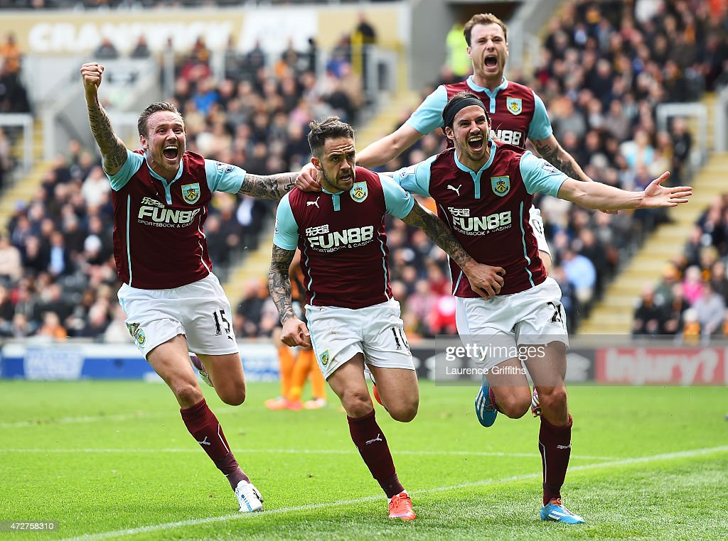 Danny Ings (2ndL) of Burnley celebrates scoring the opening goal with Matthew Taylor (L), George Boyd and Ashley Barnes (top) of Burnley during the Barclays Premier League match between Hull City and Burnley at KC Stadium on May 9, 2015 in Hull, England.