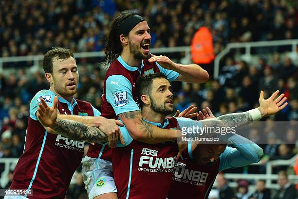 Danny Ings of Burnley celebrates scoring their second goal with team mates during the Barclays Premier League match between Newcastle United and...