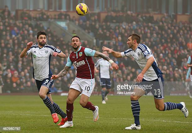 Danny Ings of Burnley is challenged from Claudio Yacob and Gareth McAuley of West Bromwich Albion during the Barclays Premier League match between...