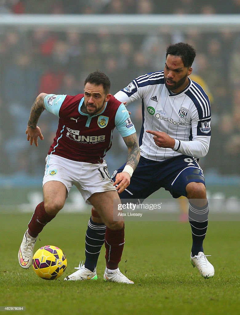 Danny Ings of Burnley is marshalled by Joleon Lescott of West Brom during the Barclays Premier League match between Burnley and West Bromwich Albion at Turf Moor on February 8, 2015 in Burnley, England.