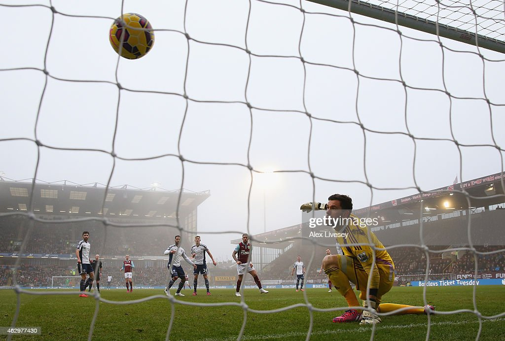 Danny Ings of Burnley scores their second goal past Ben Foster of West Brom during the Barclays Premier League match between Burnley and West Bromwich Albion at Turf Moor on February 8, 2015 in Burnley, England.