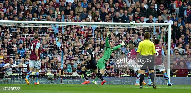 Danny Ings of Burnley scores with a header at Villa Park on May 24 2015 in Birmingham England