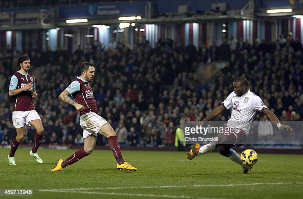 Danny Ings of Burnley shoots at goal as Jores Okore attempts to block during the Barclays Premier League match between Burnley and Aston Villa at...