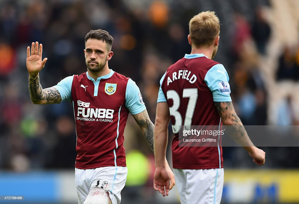 Danny Ings (L) of Burnley waves to fans after his team were relegated after the Barclays Premier League match between Hull City and Burnley at KC Stadium on May 9, 2015 in Hull, England.