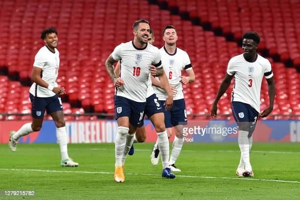 Danny Ings of England celebrates with his team after scoring his sides 3rd goal during the international friendly match between England and Wales at...