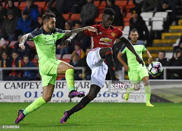 Danny Ings of Liverpool and Axel Tuanzebe of Manchester United in action during the Premier League 2 match between Manchester United and Liverpool at...