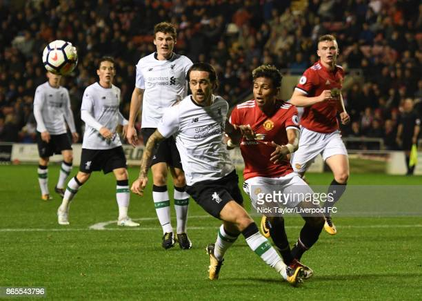 Danny Ings of Liverpool and Demetri Mitchell of Manchester United in action during the Manchester United v Liverpool Premier League 2 game at Leigh...