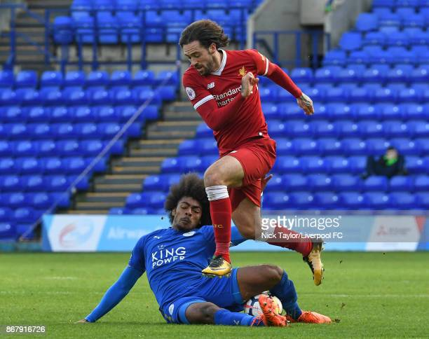 Danny Ings of Liverpool and Hamza Choudhury of Leicester City in action during the Liverpool v Leicester City PL2 game at Prenton Park on October 29...