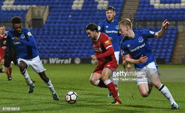 Danny Ings of Liverpool and Harry Charsley and Beni Baningime of Everton in action during the Liverpool v Everton Premier League 2 game at Prenton...