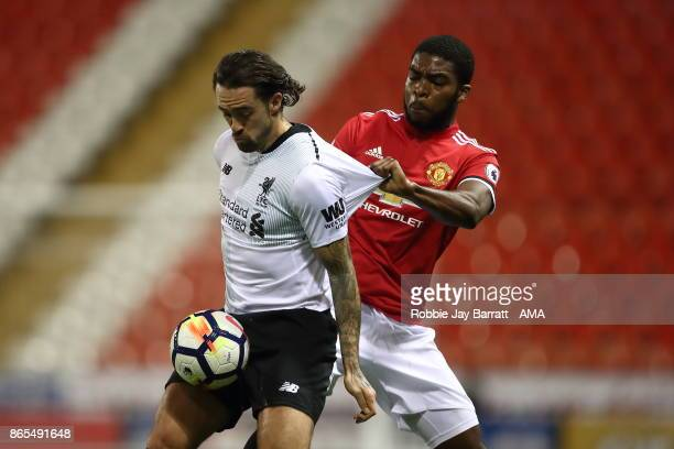 Danny Ings of Liverpool and RoShaun Williams of Manchester United during the Premier League 2 fixture between Manchester United and Liverpool at...