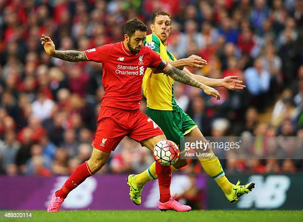 Danny Ings of Liverpool battles with Steven Whittaker of Norwich City during the Barclays Premier League match between Liverpool and Norwich City at...