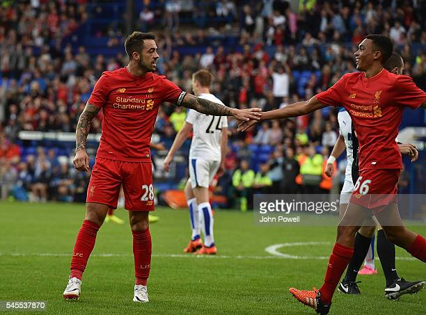 Danny Ings of Liverpool celebrates after scoring the opening goal during a PreSeason Friendly match between Tranmere Rovers and Liverpool at Prenton...