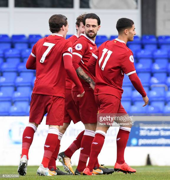 Danny Ings of Liverpool celebrates his first goal of the game with team mates Harry Wilson and Yan Dhanda during the U23 Premier League Cup between...