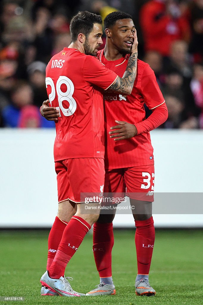 Danny Ings of Liverpool celebrates with Jordan Ibe of Liverpool after scoring a goal during the international friendly match between Adelaide United and Liverpool FC at Adelaide Oval on July 20, 2015 in Adelaide, Australia.