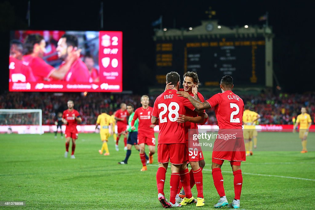 Danny Ings of Liverpool celebrates with team mates after scoring the second goal during the international friendly match between Adelaide United and Liverpool FC at Adelaide Oval on July 20, 2015 in Adelaide, Australia.