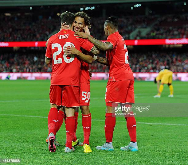 Danny Ings of Liverpool celebrates with teammates after scoring the second during the international friendly match between Adelaide United and...