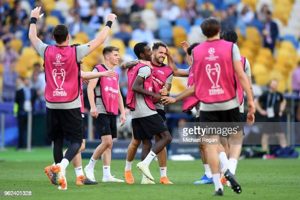 Danny Ings of Liverpool celebrates with teammates during a Liverpool training session ahead of the UEFA Champions League Final against Real Madrid at...