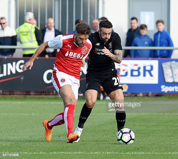 Danny Ings of Liverpool competes with Joe Davis of Fleetwood Town during the PreSeason Friendly match bewteen Fleetwood Town and Liverpool at...