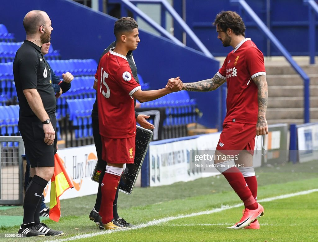 Danny Ings (right) of Liverpool leaves the field replaced by Yan Dhanda during the Liverpool v Sunderland U23 Premier League game at Prenton Park on August 20, 2017 in Birkenhead, England.