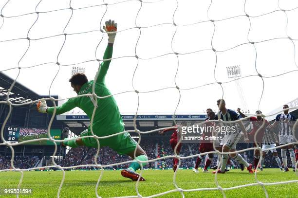 Danny Ings of Liverpool scores his sides first goal past Ben Foster of West Bromwich Albion during the Premier League match between West Bromwich...