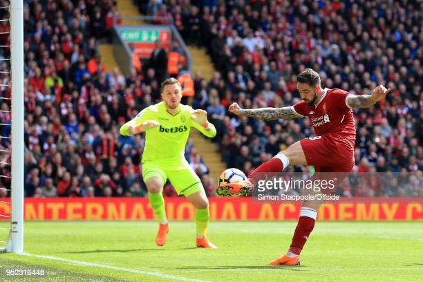 Danny Ings of Liverpool scores only to see the goal disallowed during the Premier League match between Liverpool and Stoke City at Anfield on April...